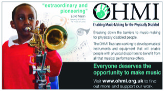 Boy playing brass instrument with support