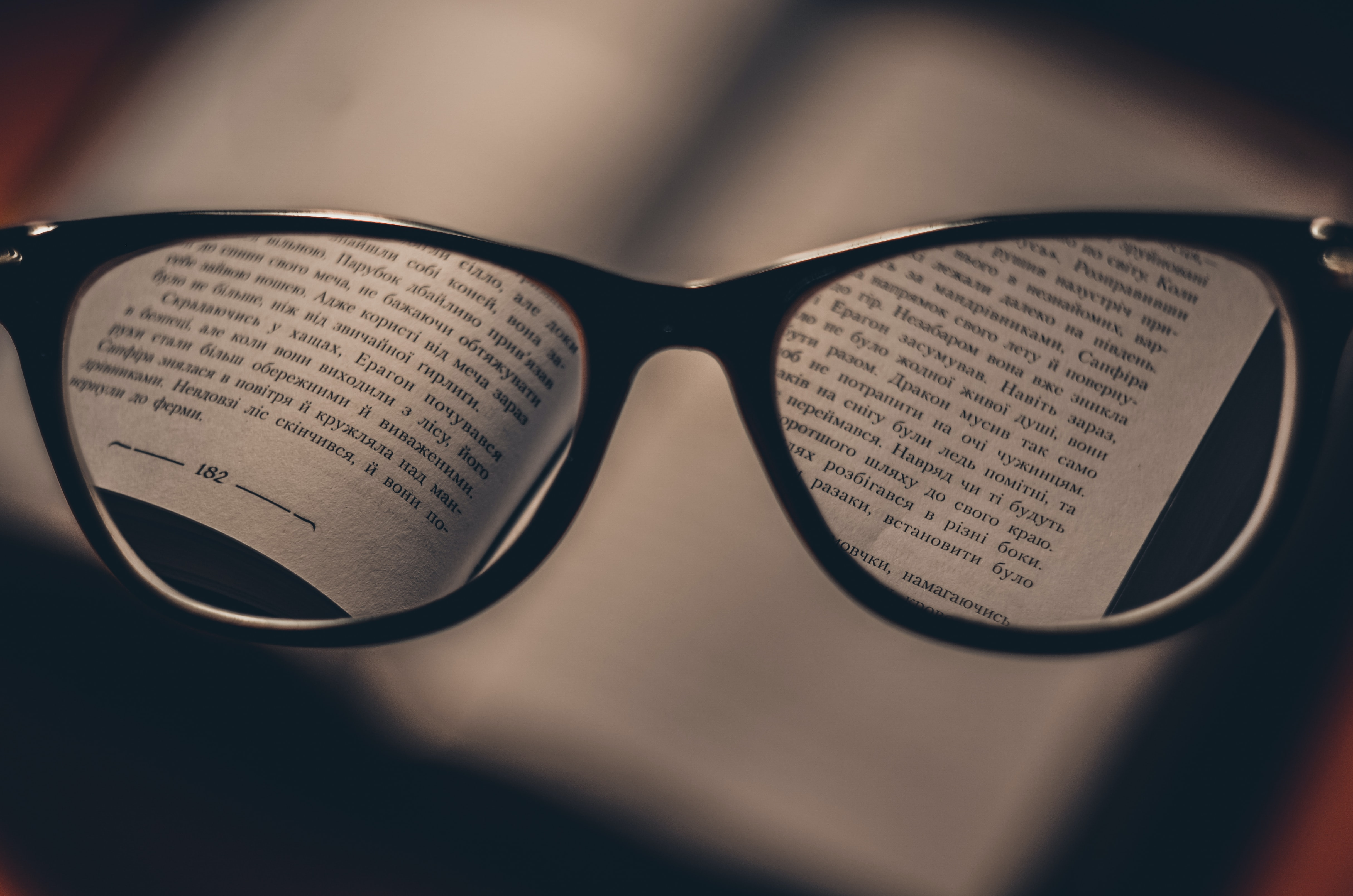 Reading glasses in front of a book