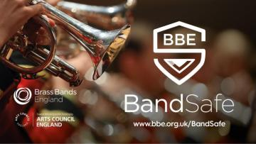 BandSafe logo of an S shaped like a shield, next to a cornet being played