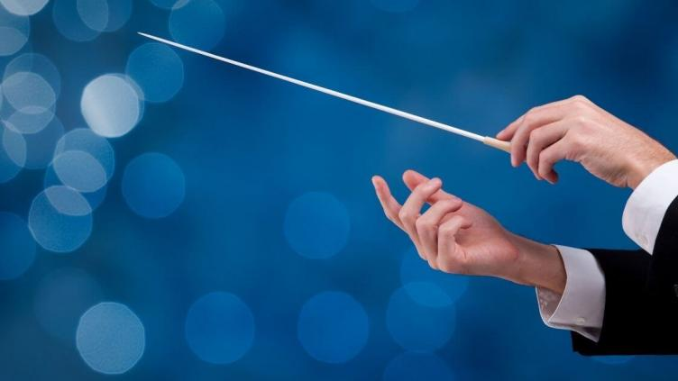 Conductor's hands holding a baton