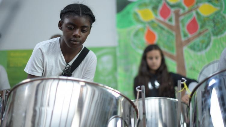 Picture of children playing steel drums